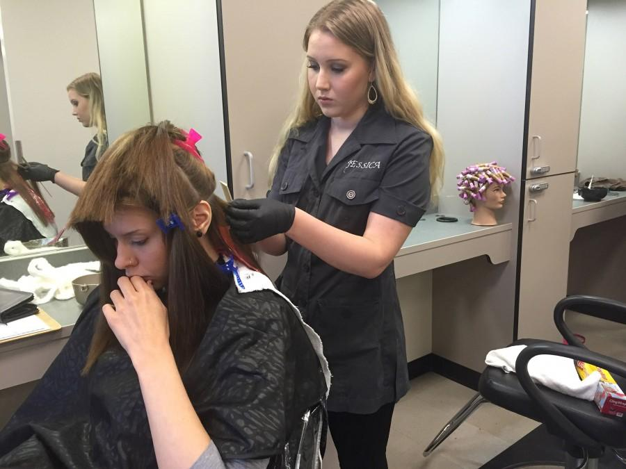 Jessica is starting an balyage style ombre to Lauren's hair