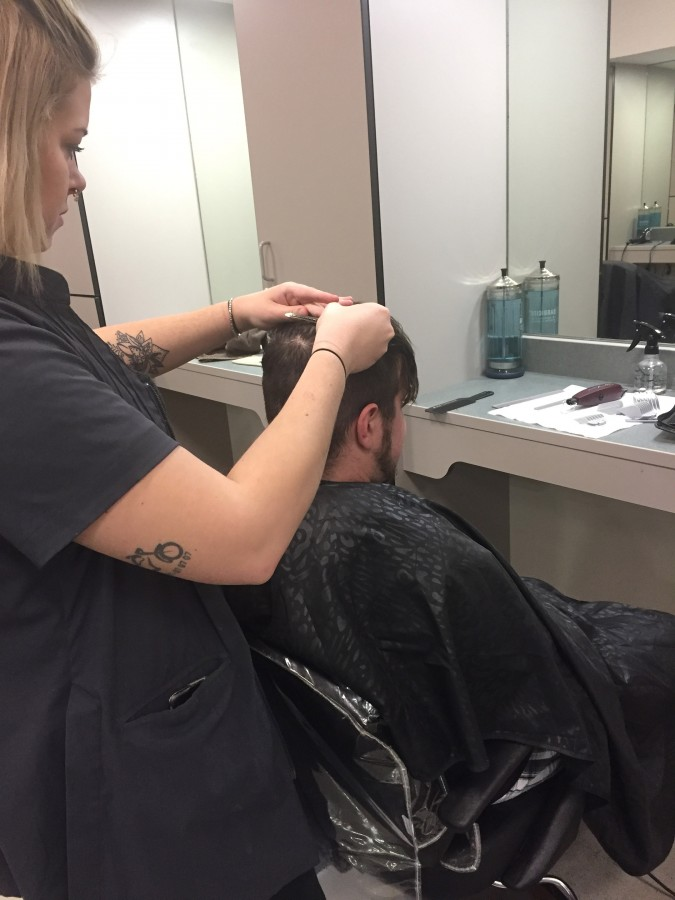 Sierra preparing to do a fade on Zach to complete his pompadour.