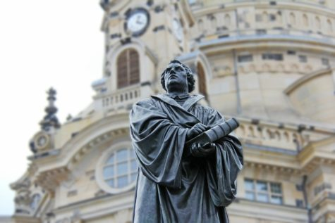 A monument to Martin Luther stands outside of the Church of Our Lady in Dresden, Germany. The statue, sculpted in 1885, survived the bombing of the church. It has since been restored and stands in front of the reconstructed church today. Luther began the Protestant revolution by publishing his 95 Theses against the Catholic Church.