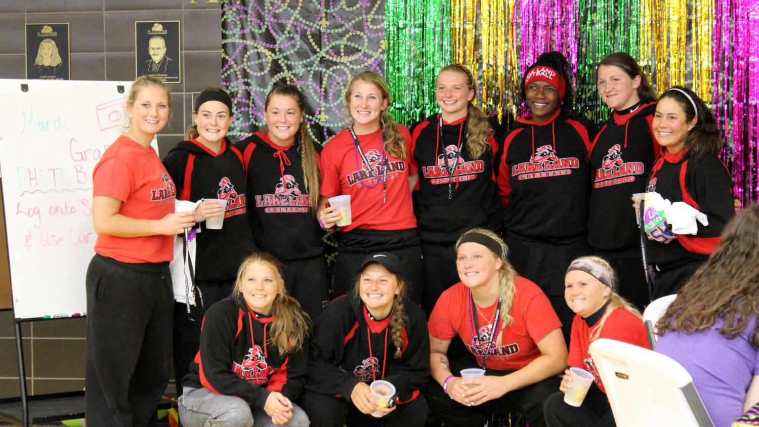 The softball team takes advantage of the Spring Carnival photo booth.