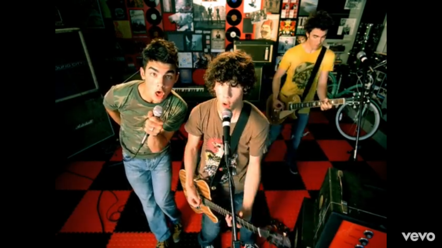 The+JoBros+jam+out+in+this+screenshot+from+the+music+video+for+%27Year+3000%27