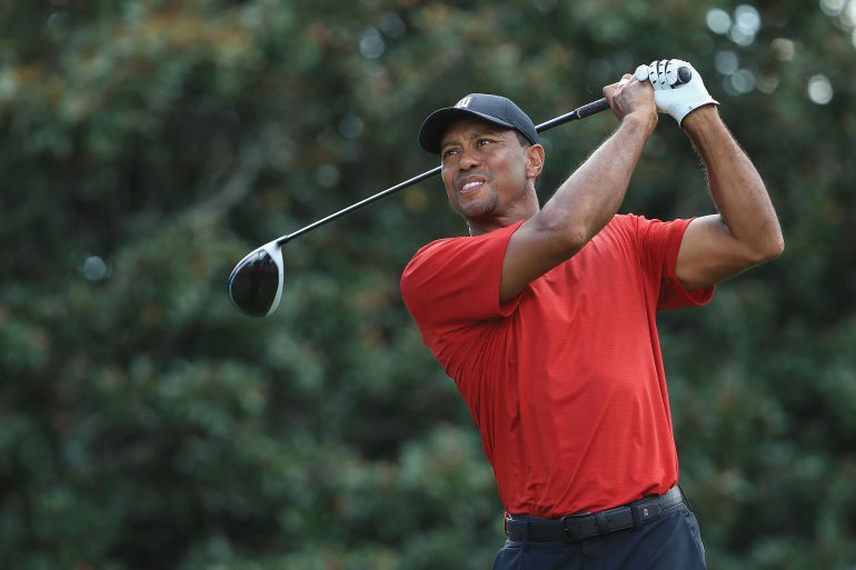 Tiger Woods comes back swinging