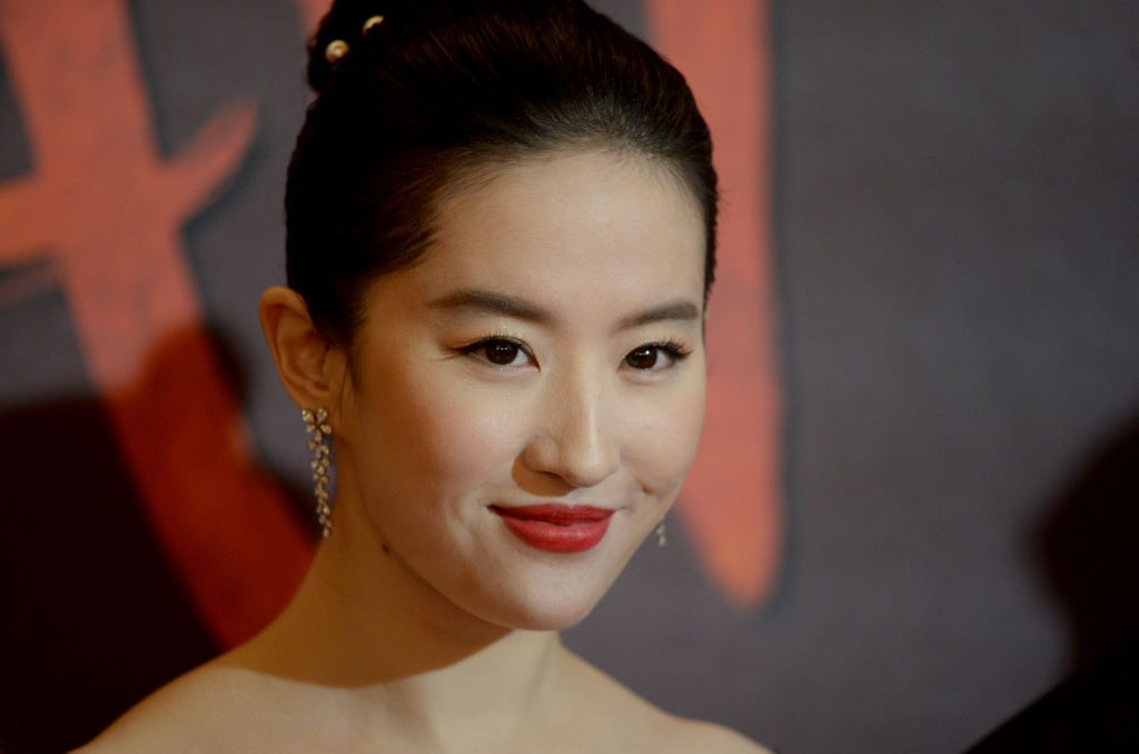 """LONDON, ENGLAND - MARCH 13: Yifei Liu attends the """"Mulan"""" photocall at Trafalgar Hotel on March 13, 2020 in London, England. (Photo by Dave J Hogan/Getty Images)"""